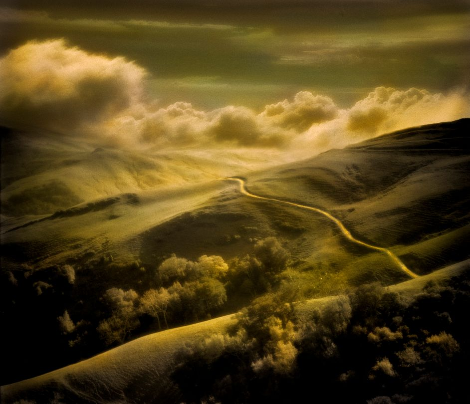 Over The River by Rocky Schenck from his book The Recurring Dream, featuring Rocky's black and white photographs hand tinted with color oils.