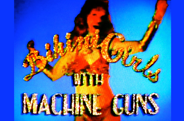 The Cramps in the music video Bikini Girls With Machine Guns, directed by Rocky Schenck