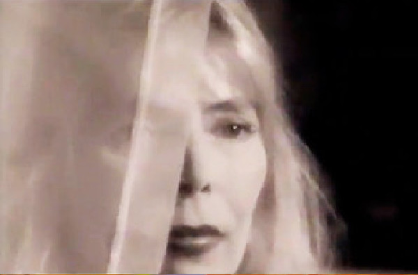 Joni Mitchell in the music video Two Grey Rooms, directed by Rocky Schenck